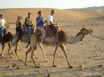 Riding a camel on the desert